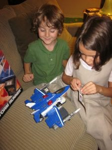 Kids applying stickers to Tomica Jet
