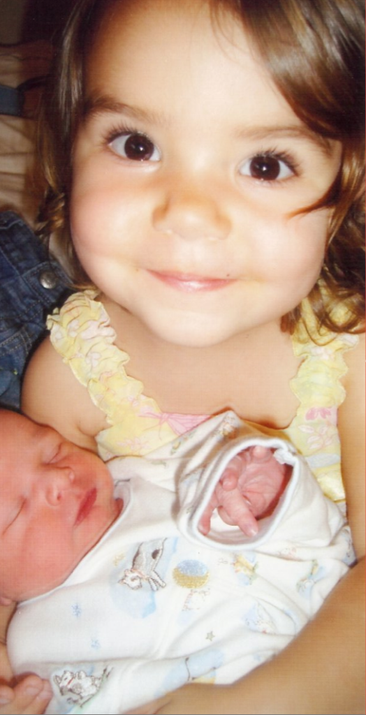 """My daughter wearing the dress her baby brother """"brought her"""" and holding him"""
