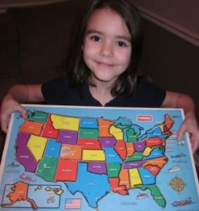 child with puzzle map