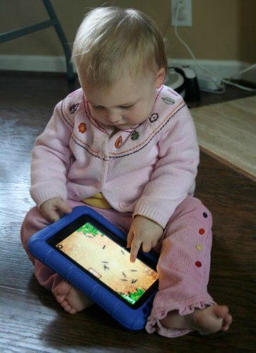 baby playing on ipad / Family Focus Blog