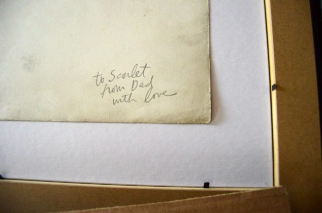 Note inside picture frame